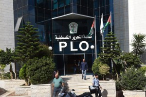Palestinians stand outside Palestinian Liberation Organization headquarters in Ramallah, West Bank, on Monday. Photo by Debbie Hill/UPI | License Photo
