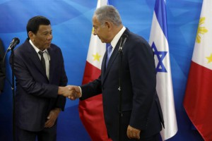 Israeli Prime Minister Benjamin Netanyahu (R) shakes hands with Philippine President Rodrigo Duterte during their meeting in Jerusalem on Monday. Pool photo by Ronen Zvulun/UPI | License Photo