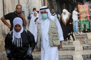 A Palestinian wears a mask to protect from swine flu in the Old City of Jerusalem. New research suggests poor-quality health care results in about 5 million deaths a year in low- and middle-income countries. File Photo by Debbie Hall./UPI | License Photo