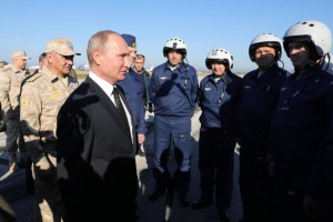 Russian President Vladimir Putin meets with Russian servicemen at an airbase southeast of Latakia, Syria. A Russian military jet was shot down near the base Monday. File Photo by Michael Klimentyev/EPA-EFE