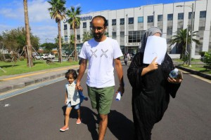 A group of Yemeni asylum seekers leave the immigration office on the southern Jeju Island on Friday after being granted permits to stay in South Korea. Photo by Yonhap