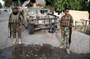 Afghan security officials secure a checkpoint in the Bahsood district of Nangarhar province, Afghanistan, on August 6. Taliban attacks late Thursday killed at least 37 people, authorities said. File Photo by Ghulamullah Habibi/EPA-EFE