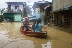 Residents ride a raft in floodwaters in San Mateo town of Rizal Province, east of Manila, Philippines, on Saturday. Mangkhut is the most powerful typhoon to strike the Philippines in the last five years, made landfall in the northeastern town of Baggao. Photo by Rolex Dela Pena/EPA