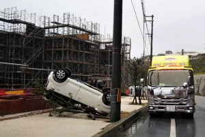 A car lies on its roof due to strong winds generated by Typhoon Trami in Kitanakagusuku, on the southern island of Okinawa, Japan, on Saturday. Photo by Hitoshi Maeshiro/EPA-EFE