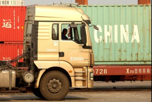 Chinese truck drivers transport cargo containers to a port in Yingkou, China, a major port city in Liaoning Province, on July 18. Photo by Stephen Shaver/UPI | License Photo
