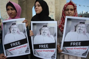 Palestinian activists hold posters of missing Saudi journalist Jamal Khashoggi in Rafah, Gaza Strip, on Tuesday. Photo by Ismael Mohamad/UPI | License Photo