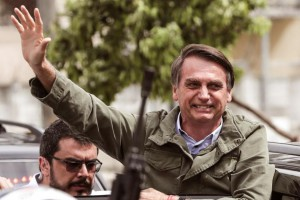 Social Liberal Party Jair Bolsonaro waves to supporters after voting in the second round of Brazil's presidential election at a polling station in Rio de Janeiro on Sunday. Photo by Antonio Lacerda/EPA