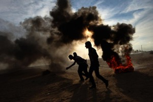 Palestinian demonstrators take part in a weekly protest at the Israel-Gaza border east of Rafah in the southern Gaza Strip on Friday. Photo by Ismael Mohamad/ UPI | License Photo