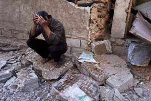 A Syrian man mourns after an alleged chemical attack on the rebel-held town of Douma, Syria. File Photo by Mohammed Hassan/UPI | License Photo