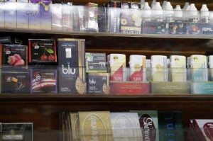 Electronic cigarettes and other tobacco products are seen at a store in New York City. Friday, the FDA warned e-cigarette makers and importers to comply with new agency regulations aimed at preventing their marketing to young adults and children. File Photo by John Angelillo/UPI | License Photo