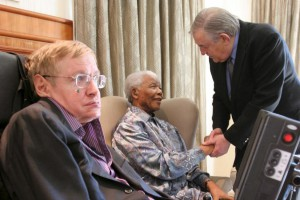 Former President Nelson Mandela shakes hands with former South African Foreign Minister Pik Botha, at right, during a meeting with British scientist Stephen Hawking in Johannesburg, South Africa, on May 15, 2008. File photo by Denis Farrell/EPA