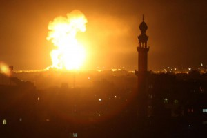 A fireball explodes during Israeli airstrikes in Rafah in southern Gaza on Saturday. Fighter jets and helicopters pounded targets in Gaza for more than 2 hours, including Hamas sites, the Israeli army said. Photo by Ismael Mohamad/UPI | License Photo