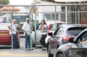 Israeli drivers wait to enter the Barkan industrial area Sunday after Israeli security forces closed the site near the Israeli settlement in the West Bank. Two Israeli were killed and another was wounded at a factory in the industrial zone. Photo by Alaa Badarneh/EPA