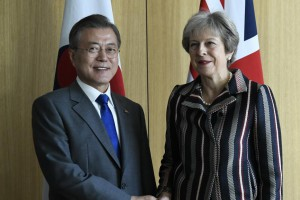South Korea's President Moon Jae-in poses with Britain's Prime Minister Theresa May during the Asia-Europe Meeting in Brussels on Friday. Moon called for support from ASEM member states for his continued engagement with North Korea. Pool Photo by Piroschka Van De Wouw/EPA-EFE