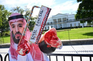 A protester dressed as Saudi Crown Prince Mohammed bin Salman stands outside the White House on Friday with members of the activist group Code Pink. Photo by Kevin Dietsch/UPI | License Photo