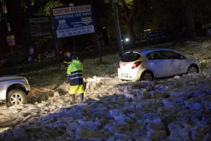 Mounds of hail piled up on streets in Rome as powerful storms brought severe weather conditions throughout Italy beginning Sunday. Photo by Massimo Percossi/EPA