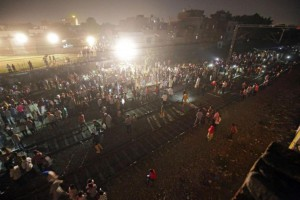 Attendees of a Hindu festival in Amristar, India, gather on railroad tracks on Friday after a train struck a group of people, killing at least 50. Photo by Raminder Pal Singh/EPA-EFE