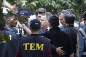 Turkish police accompany U.S. pastor Andrew Brunson, center, to his house after he was released Friday following a trial at the Aliaga Prison Court in Izmir, Turkey. Photo by Tolga Bozoglu/EPA-EFE