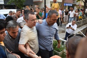 U.S. pastor Andrew Brunson, center, is released from jail in Turkey and placed under house arrest on July 25. Photo by Mustafa Koprulu/EPA-EFE/