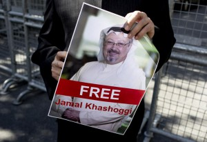 A protester holds a picture of Saudi Journalist Jamal Khashoggi during a demonstration organized by Turkish-Arabic Media Association in front of the Saudi Arabian consulate in Istanbul, Turkey. Turkish officials believe he was killed inside the consulate after he disappeared on Oct. 2. Photo by Sedat Suna/EPA