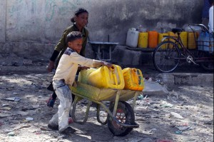 Yemeni children push a wheelbarrow with jerrycans filled with drinking water from a donated water pipe in Sanaa, Yemen, on November 18, 2017. Photo by Yahya Arhab/EPA-EFE