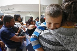 Migrant families are processed at the central bus station before being taken to Catholic Charities in McAllen, Texas, on June 29. File Photo by Larry W. Smith/EPA-EFE