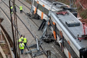 Emergency personnel work next to the derailed train in Vacarisses, Spain, Tuesday. Photo by Susanna Saez/EPA-EFE