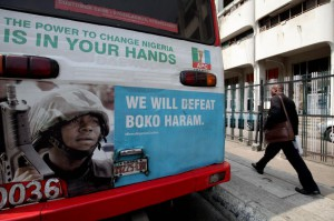 A bus displays an advertisement for the fight against militant group Boko Haram in Lagos, Nigeria. The group has been highly active in Nigeria for years. File Photo by Ahmed Jallanzo