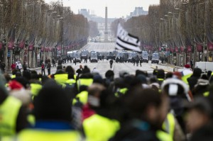 "Protesters gather during a ""yellow jacket"" demonstration on the Champs Elysees in Paris, on Saturday. Photo by Etienne Laurent/EPA"