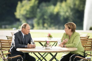 Russian President Vladimir Putin speaks with German Chancellor Angela Merkel August 18 near Berlin, Germany. Photo by Steffen Kugler/EPA-EFE