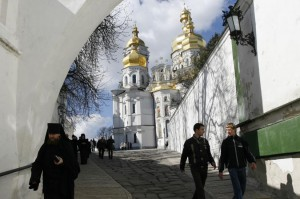 A monk and tourists walk in the Monastery of the Caves called Pechersk Lavra in Kiev. Ukrainian priests are expected to meet Saturday to formalize plans to to create a new Orthodox church independent of Russian influence. File Photo by Sergey Starostenko