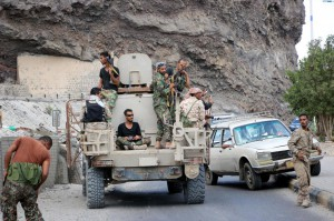 Armed separatist members patrol a street in the southern port city of Aden, Yemen. Photo by EPA-EFE