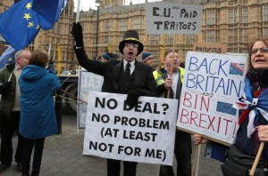 Brexit protestors campaign outside Houses of Parliament whilst the Members of Parliament prepare to vote on this evening's vital Brexit vote on Tuesday. Photo by Hugo Philpott