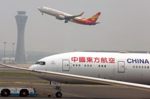 Airliners take off and land at Beijing International Airport on July 5. The Canadian government has warned citizens against traveling to China due to fallout from the arrests of business executives in both nations. File Photo by Stephen Shaver