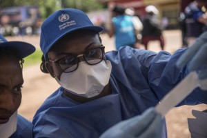 A World Health Organization worker prepares to administer an Ebola vaccination in Mbandaka, Democratic Republic of the Congo, on May 21