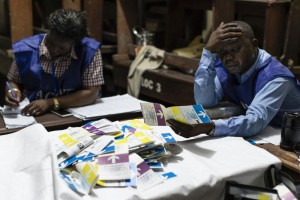 An election clerk reacts as he and others count votes at a polling station in Kinshasa, Democratic Republic of the Congo. The National Independent Electoral Commission postponed the release of provisional election results originally scheduled for Sunday. Photo by Stefan Kleinowitz