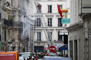 Firefighters are at the scene of an explosion at a bakery and apartment building on Rue de Trevise in Paris on Saturday. The death toll rose to four with the discovery of a woman's body. photo by Ian Langsdon/