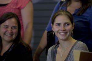 Amanda Knox, right, and her mother Edda smile at a crowd of supporters during a news conference held at the Seattle-Tacoma International Airport when she came home on October 4, 2011. The European Court of Human Rights ordered Italy to pay Knox damages. Photo by Jim Bryant