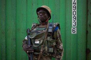 A Gabon soldier is seen securing the St. Joseph Cathedral in Bambari, Central African Republic. Gabon forces seized a state-run radio station Monday as a result of a power struggle following the hospitalization of the country's president. File Photo by Tanya Bindra