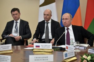 Russian President Vladimir Putin (R), Finance Minister Anton Siluanov (C) and Energy Minister Alexander Novak (L) attend a meeting of the Eurasian Economic Union in St.Petersburg, Russia, to discuss issues including energy on Dec. 6, the same day OPEC countries met in Vienna. Photo by Alexey Nikolsk
