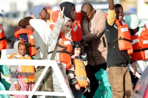 Migrants who had been stranded on two NGO rescue ships off the coast of Malta for several days disembark from the Maltese Armed Forces ship in Floriana, Malta, on Wednesday. Photo by Domenic Aquilina