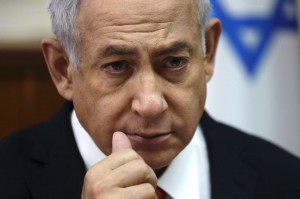 Israeli Prime Minister Benjamin Netanyahu convenes his cabinet for a weekly meeting in Jerusalem on Sunday. He announced Israeli military destroyed Iranian weapons caches in Syria's Damascus airport during airstrikes over the weekend