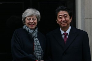 Japanese Prime Minister Shinzo Abe (R) met with Britain's Theresa May on Jan. 10. File Photo by Hugo Philpott