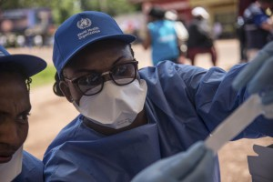 A World Health Organization worker prepares to administer Ebola vaccination during the launch of an experimental vaccine in Mbandaka, Democratic Republic of the Congo. On Wednesday the country's health ministry reported 608 Ebola cases and 268 deaths since the latest outbreak began in August