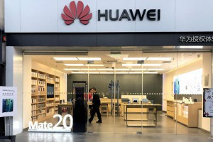 A Chinese man shops in a Huawei computer and smartphone showroom in Beijing on December 10. Photo by Stephen Shaver