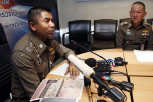 Thai Immigration Police Chief Surachet Hakparn evaluates a copy of a passport of Rahaf Mohammed Alqunun, a Saudi Arabian girl who seeks for asylum and has barricaded herself at a hotel room, in Bangkok, Thailand, Monday. Photo by Rungroj Yongrit
