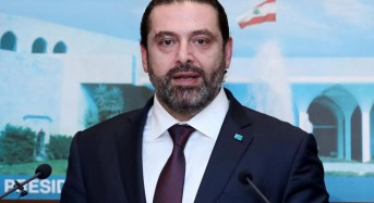 After 8-month conflict, Lebanon adopts new government with Hezbollah