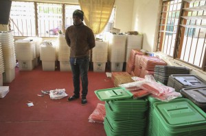 A Nigerian electoral official inspects materials at the Independent National Electoral Commission offices in Daura, Katsina, Nigeria on Saturday. Photo by George Esiri