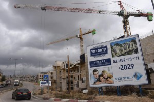 A billboard advertises new Jewish housing in the Israeli settlement of Har Homa, located in the West Bank between Jerusalem and Bethlehem, on January 3, 2017. Photo by Debbie Hill