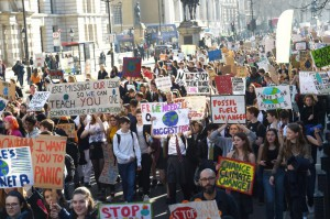 Students hold placards and shout slogans as they take part in a climate change protest organized by Youth Strike 4 Climate in Parliament Square in central London on Friday. Photo by Facundo Arrizabalaga